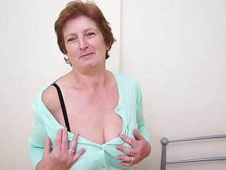 Solo granny Slicklips moans while she drills her cunt almost a toy