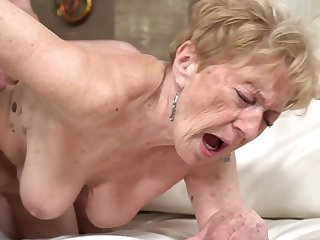 A nasty old granny is getting fucked nigh her pussy doggy air