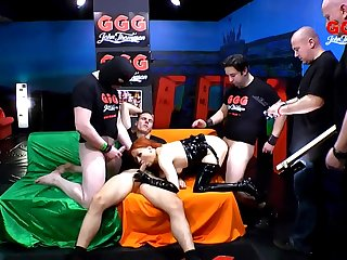 Kinky redhead in latex gangbanged by a big group be required of guys