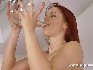 This spectacular skanky redhead has a pee fetish together with she is always pee thirsty