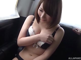 Busty Japanese MILF fucked and abused by two guys in a car