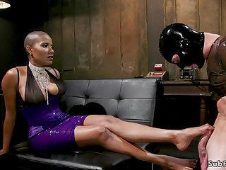 Ebony dom torments penis to man
