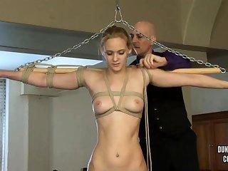 Amazing blonde enjoys fetish BDSM games with a dildo