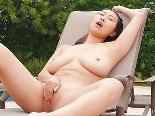 Extensive natural tits model Sharon spreads her legs to masturbate