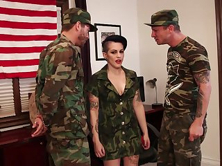 Depraved army bitch with big boobies is busy with sucking delicious cocks