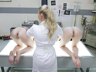 Kinky nurse is fucking slutty anal holes of Audrey Holiday and her red haired girlfriend